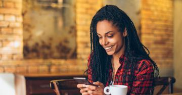 Young-woman-using-cell-phone-apps