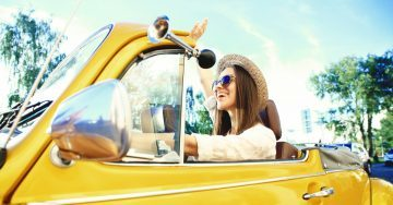 Young-Woman-Happy-in-Convertible-Car