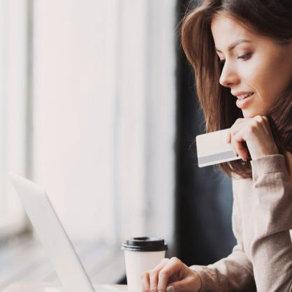 Woman Shopping Online Earning Cashback with Ebates