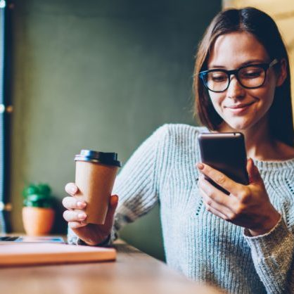 Woman Taking Paid Surveys On Cell Phone